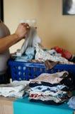 Sorting clothes Stock Photos
