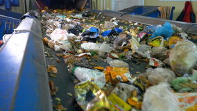 Sorting conveyor belt in a recycling plant. stock video footage