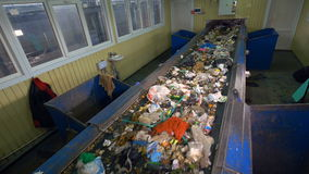 Sorting conveyor belt in a recycling plant. stock footage