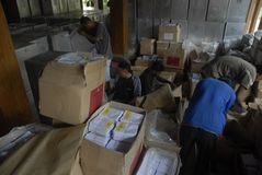 SORTING ELECTION BALLOT PAPERS. Volunteers are sorting ballot papers prior to Indonesian General Election, at Solo, Java, Indonesia Royalty Free Stock Photos