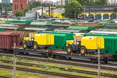 Sorting freight railway station in the city wagons for trains, with tractors and machines. Sorting freight railway station in the city wagons for trains, with Royalty Free Stock Photos