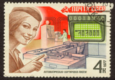 Sorting of letters. The scanned Soviet stamp. Stamp of 1977. Ancient stamp Stock Photography
