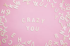 Sorting letters Crazy you on pink. Sorting letters Crazy you on pink royalty free stock image
