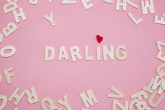 Sorting letters Darling on pink background.  stock photos