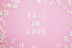 Sorting letters Fall in love on pink. Sorting letters Fall in love on pink Royalty Free Stock Image