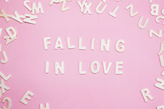 Sorting letters Fall in love on pink. Sorting letters Fall in love on pink Royalty Free Stock Images