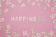 Sorting letters Happiness on pink. Sorting letters Happiness on pink Royalty Free Stock Photography
