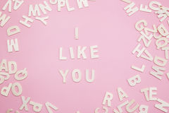 Sorting letters i like you on pink. Stock Image