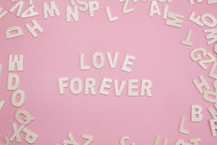 Sorting letters Love forever on pink. Sorting letters Love forever on pink Stock Images