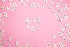 Sorting letters MISS YOU on pink. Sorting letters MISS YOU on pink Stock Image