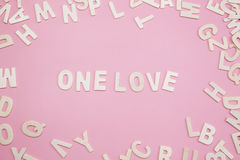 Sorting letters One love on pink. Sorting letters One love on pink Royalty Free Stock Photography