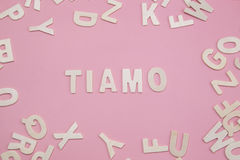 Sorting letters Tiamo on pink. Sorting letters Tiamo on pink background royalty free stock photography