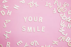 Sorting letters Your smile on pink. Sorting letters Your smile on pink Royalty Free Stock Images