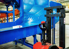 Sorting line in Large warehouse. Sorting line for cargo in large modern warehouse with forklifts stock photo