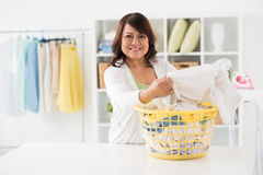 Sorting out clothes Stock Image