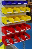 Sorting parts bins. Colourful plastic sorting bins with nuts and bolts royalty free stock images