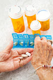 Sorting Pills. Closeup of an elderly woman\'s hands sorting her medication for the week Royalty Free Stock Photography