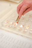 Sorting Pills. Manual Sorting Medications for patients royalty free stock images