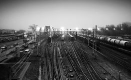 Sorting railway station with cargo trains at night. Black and white photo Royalty Free Stock Photography