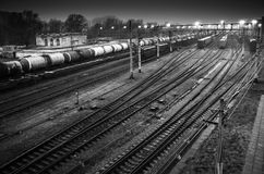Sorting railway station with cargo trains. On rails at night, black and white photo royalty free stock image