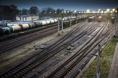 Sorting railway station with trains at night. Sorting railway station with cargo trains on rails at night Stock Photography
