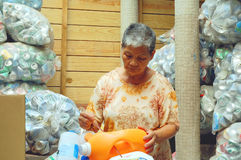 Sorting recyclables old woman Stock Image