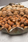 Sorts of nuts. Different sorts of nuts with nutcracker Royalty Free Stock Image