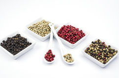 Sorts of pepper. Red, white, black and sorted peppercorns on white Stock Photo