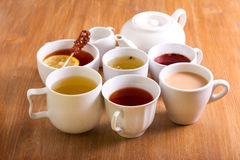 Sorts of tea. In the cups and tea pot royalty free stock photos