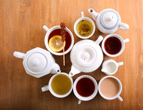 Sorts of tea in the cups and tea pots Stock Images