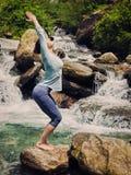 Sorty fit woman doing yoga asana Utkatasana outdoors Royalty Free Stock Image