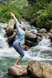 Sorty fit woman doing yoga asana Utkatasana Stock Image