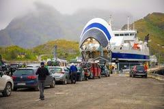 Sorvagen, Norway - 22.06.2018: Passenger ferry ship in harbor and cars waiting boarding, Norway. Sorvagen, Norway - 22.06.2018: Passenger ferry ship in harbor stock photo