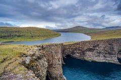 Sorvagsvatn lake cliffs over the ocean in Faroe Islands
