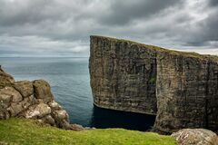 Sorvagsvatn lake cliffs over the ocean under the clouds, Faroe Islands