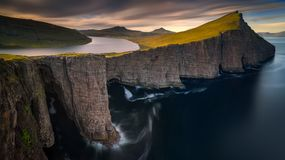 Sorvagsvatn lake. On cliffs of Vagar island in sunset, Faroe Islands Stock Images