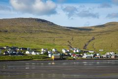 SORVAGUR, FAROE ISLANDS, DENMARK - JULY 09, 2019: Traditional faroese village with harbor beach and picturesque houses. Sorvagur