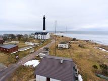 Sorve Lighthouse in Baltic sea at spring season. Peninsula in Torgu Parish, island of Saaremaa, Estonia, Europe. Sorve Lighthouse in Baltic sea at spring season Stock Images