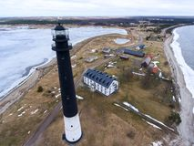 Sorve Lighthouse is black tower with horizontal wide white lower band. Peninsula in Torgu Parish, island of Saaremaa, Estonia, Eur. Sorve Lighthouse is black stock image