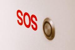 SOS卫生间在墙壁上的应急按钮 免版税库存图片