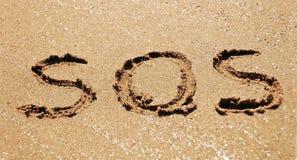 SOS άμμου Στοκ Φωτογραφίες