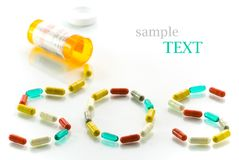 SOS. Pills spilling from orange medicine bottle and forming the word SOS royalty free stock photo