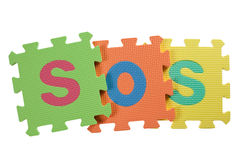 SOS. Alphabet blocks forming the letters SOS isolated on white background Stock Images