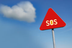 SOS. Save our souls - text on red fabric Royalty Free Stock Image