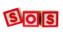SOS. Wooden blocks forming the letters SOS isolated on white background Stock Photo