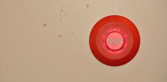 Sos button on a dirty wall Stock Images