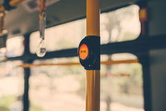 SOS button on yellow holder in modern bus.  stock photos