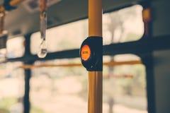 SOS button on yellow holder in modern bus.  Stock Photos