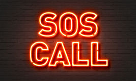SOS call neon sign. On brick wall background Royalty Free Stock Photography