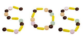 SOS call from the tablets. SOS lined the floor of different pills on a white background Stock Photo